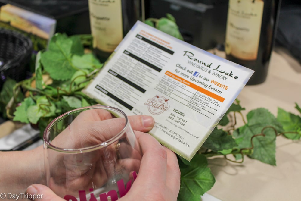 Checking out the Round Lake Winery offerings at Clink Sip and Savor Wine Festival